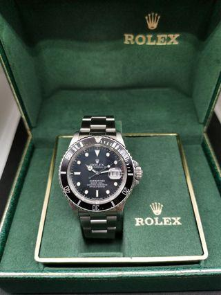 Rolex Submariner 16800, box and papers.