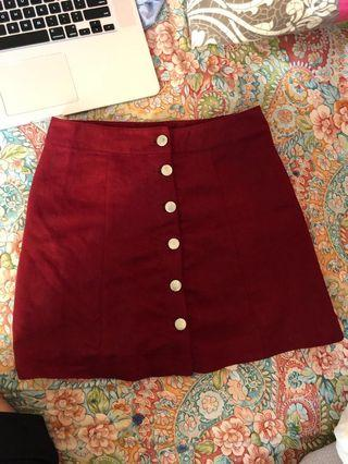 Red suede buttoned skirt