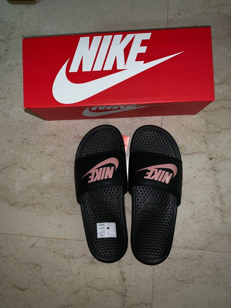 8a2a31e6d3f7 Nike Benassi Slides Rose Gold
