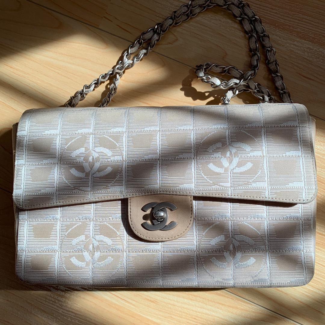 1d0c684f358c1a Vintage Chanel Beige Canvas CC Logos Travel Line Flap Two Way ...