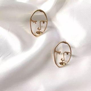 gold minimalist abstract face earrings