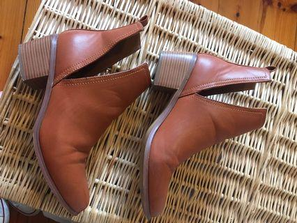 Brown cutout boots