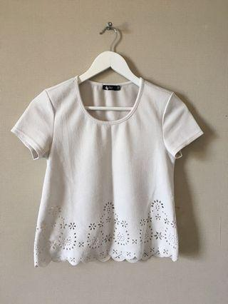 White top with cutouts
