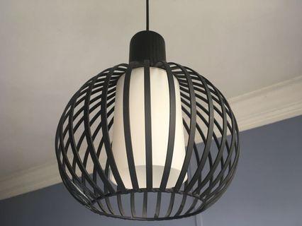 Used black cage pendent light w/warm light bulb
