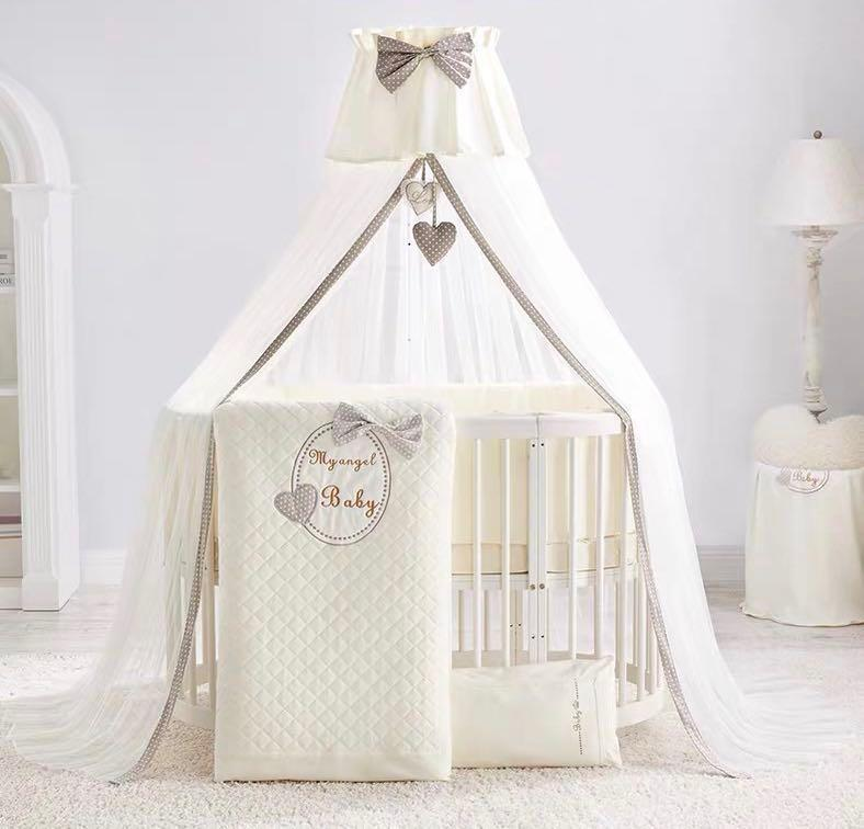 5 in 1 Multipurpose convertible Oval and Round Baby Crib. FREE TWO SETS  OF BEDDINGS+Mosquito Net+Hanging Storage Bag+Hanging Mobile Bell Toy
