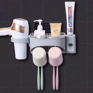 Toothbrush, toothpaste, cup, hair dryer holder