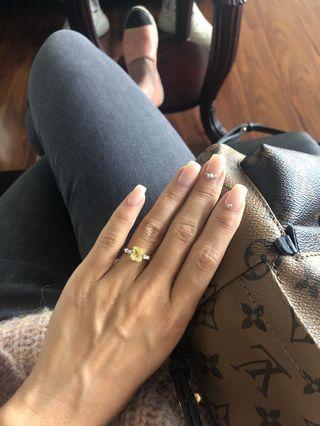 Yellow sapphire + diamond ring