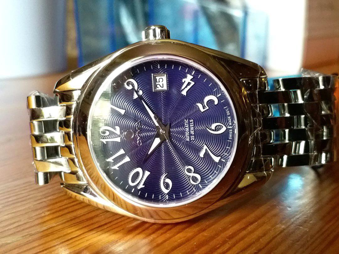 CYMA 舊款司馬錶,瑞士制造,机械自动,彩藍色錶面配弧形錶殼,適合人体手腕弧度, 美輪美奐, 全新未戴過 ,有原裝盒。