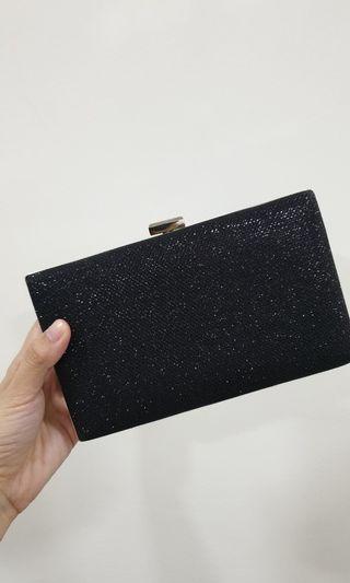 Glittery black dinner clutch