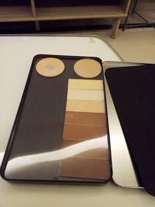 Make up for ever large metal palette with random bronzer and highlighter