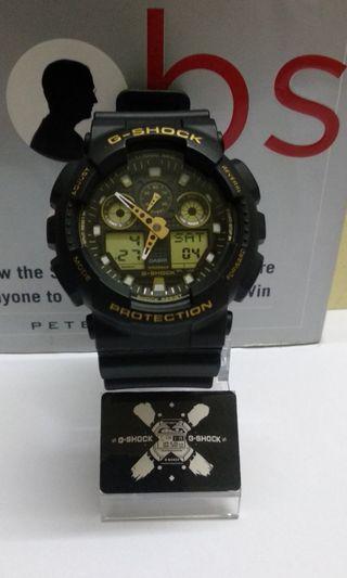 G-Shock GA-100GBX Gold Dial Buckle