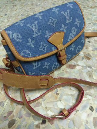 louis vuitton sling bag jeans