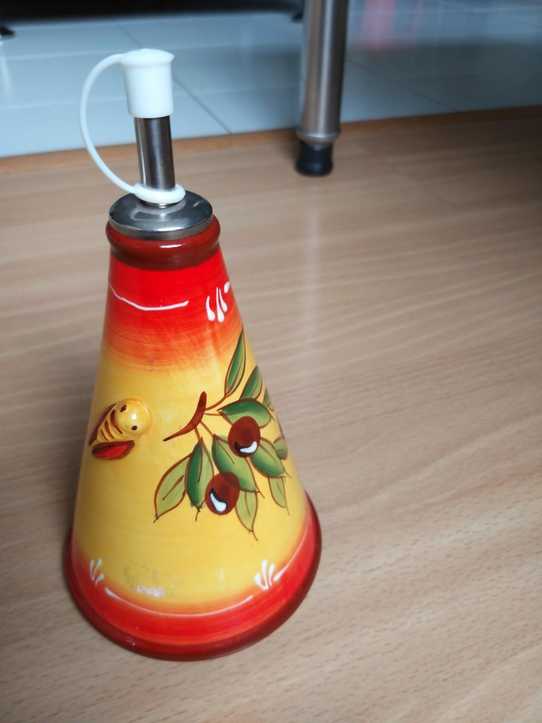 Oil pourer container
