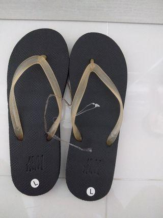 Brand new H&M luminous black flip flop for women