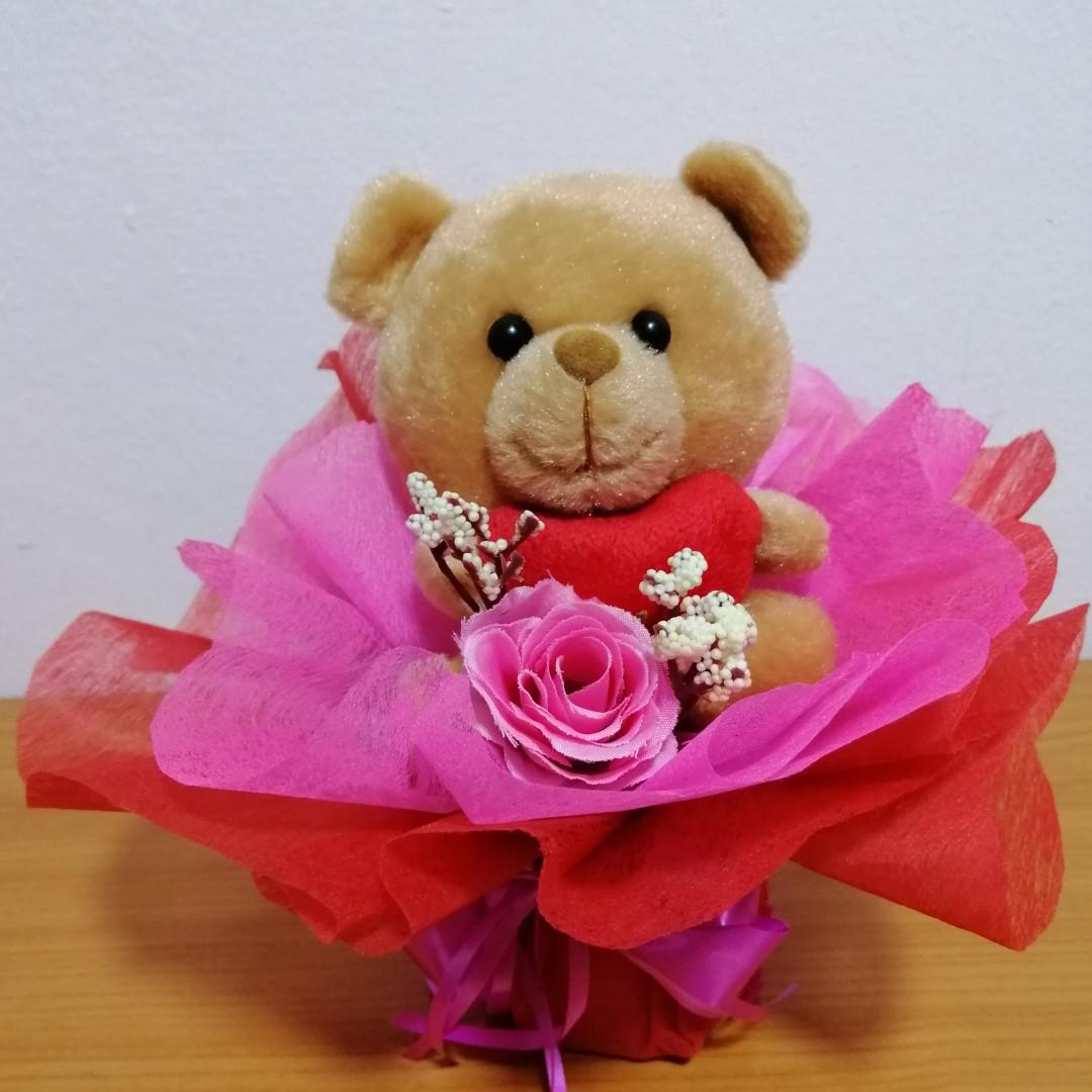 Bear with heart artificial rose bouquet