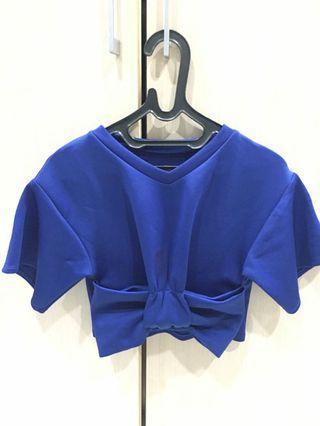 Big bow blue top
