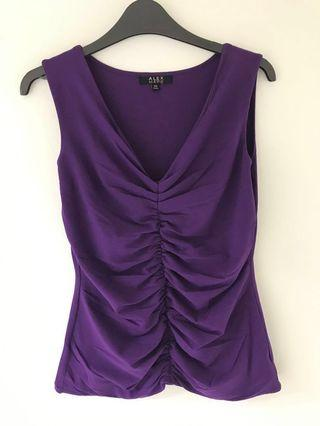 Purple or black V next top. Very stretchable. Can fit from S - XL