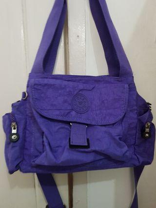 Tas Kipling pocker warna ungu