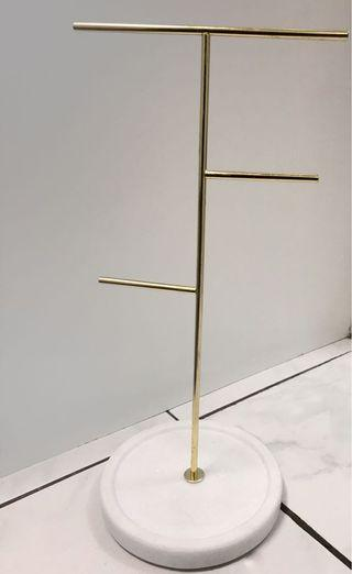 Gold and white marble jewelry stand