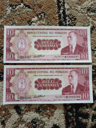 1952 Republic *Banco Central Del Paraguay* 10 Guaraníes running serial pair GEM UNC