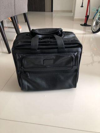 🚚 TUMI leather laptop wheel case