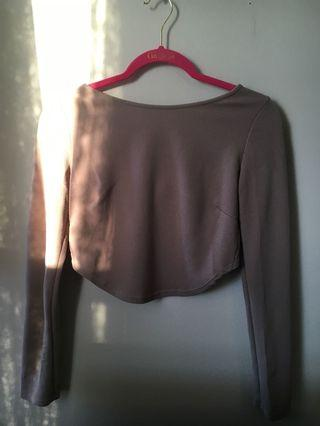 Beige long sleeve open back top