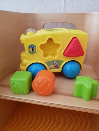Shape sorter toy yellow bus