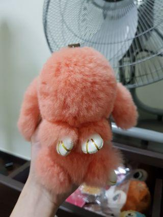 Fluffy bunny in grapefruit pink