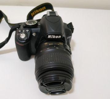 Nikon D3100 with 18-55mm lens and charger