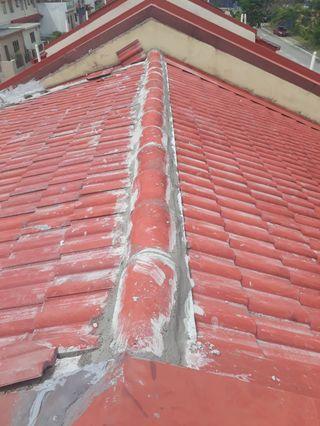 Tukang baiki bumbung bocor