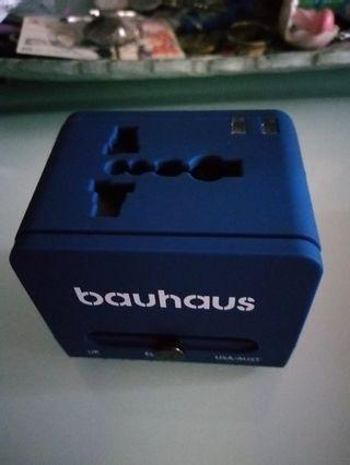 Multi-nation travel adapter with USB charger