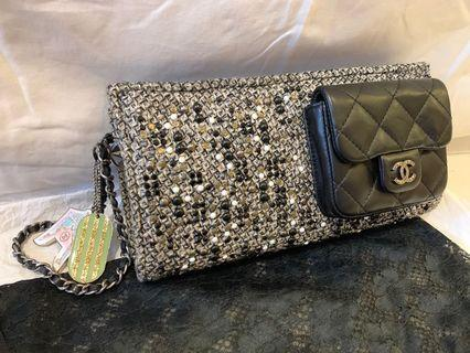 Chanel tweed and lamb skin clutch