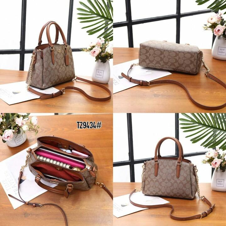 Coach Mini Sage Carryall in Signature Bag T29434#  H 850rb  Bahan pvc waterproff Di kombi dengan kulit Dalaman kain tebal Kwalitas High Premium AAA Tas uk 24x9x19cm Berat 1 kg  Warna : -Apricot/Brown