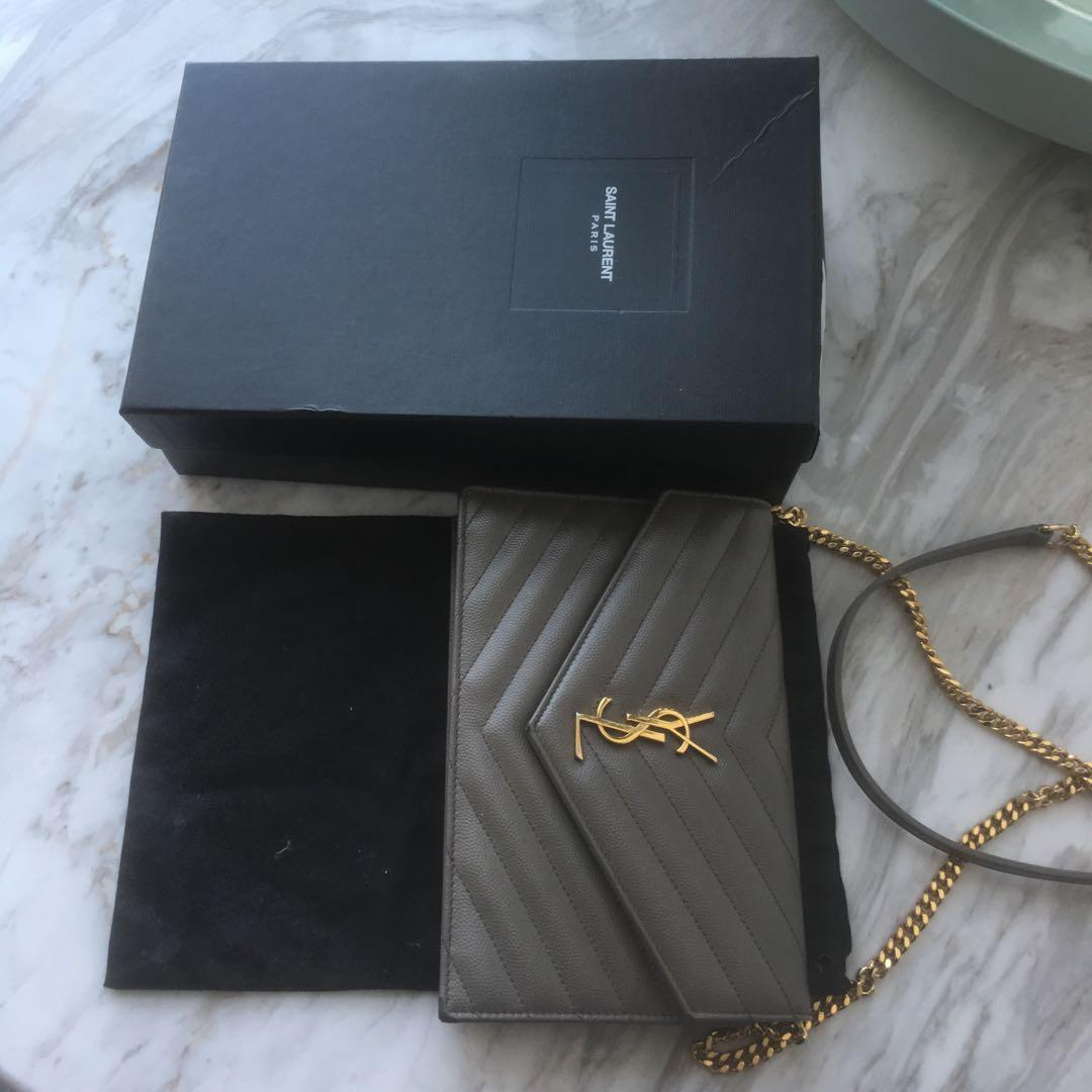 Ysl monogram genuine leather clutch on gold chain. Authentic, with proof of purchase