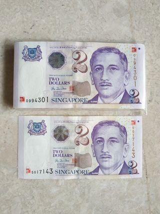 A STACK 100 PCS SINGAPORE $2 MILLENNIUM WITH REPLACEMENT 0994332-400 RUN UNC