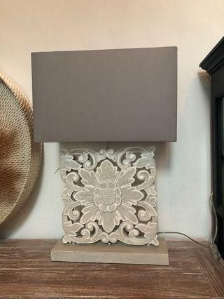 Carved table lamp with grey shade