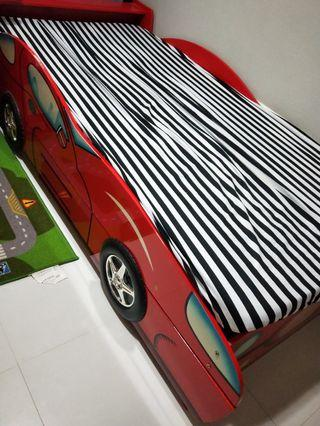 Red racing car bed frame with pull out