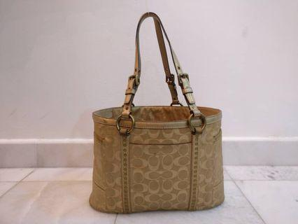 Coach's gold bag