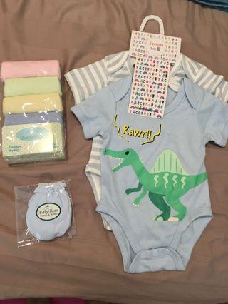 Brand new baby clothes, wash towel and mittens.