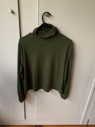 Green roll neck long sleeve top
