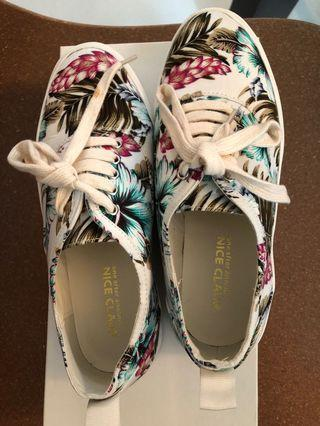 Japanese brand , NICE CLAUP sneakers with floral print.
