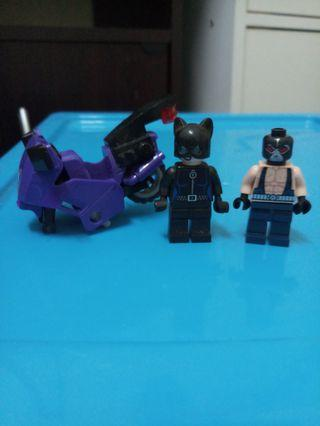 Bane and cat women with motorcycle