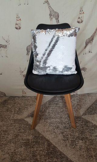 Black designer chair w/home&co glitter pillow