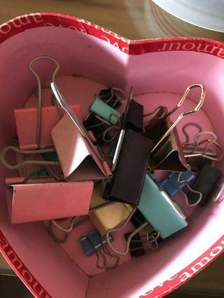 Heart-shaped Box of used bulldog clips