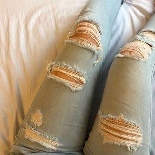 AE light blue ripped jeans