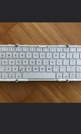 🚚 Brand new pocket foldable Bluetooth keyboard.