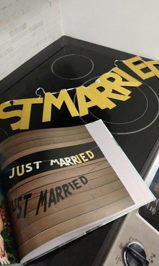 "Gold glitter ""JUST MARRIED"" sign"