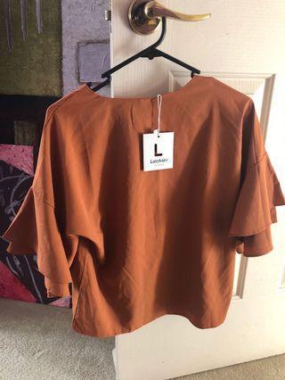 oversized brown top