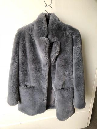 Lioness faux fur coat
