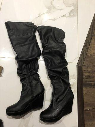 Gently used knee high wedge boots black leather-like